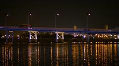 Urban Traffic Crossing an Ornate Bridge at Night Stock Footage