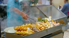 Traditional Asian Street Foods at an Outdoor Vendor's Stand Stock Footage