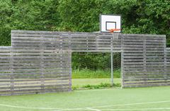 Universal playground synthetic field for soccer and basketball Stock Photos
