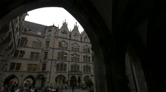 Tourists gathered in the interior courtyard of the New Town Hall, Munich Stock Footage