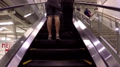 People taking escalator to the main floor inside Ikea store. Stock Footage