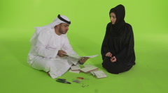 Emirati couple with work tools and blueprint. Stock Footage