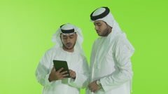 Emirati businessmen using digital tablet. - stock footage