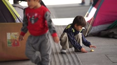 Refugee children playing Stock Footage