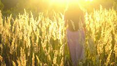 Girl with long hair out of the field with high grass Stock Footage