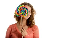 Girl hides behind giant lollypop Stock Photos