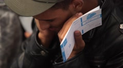 Refugee man holding his ticket Stock Footage
