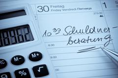 Calendar note debt Stock Photos