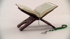 Prayer beads with Holy Quran on stand. Stock Footage