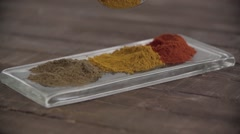 Powdered spice being poured on tray. Stock Footage