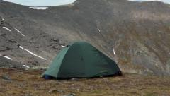 Tourist tent is mounted on a mountain top, South Rischorr pass at Khibiny massif Stock Footage