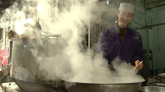 Chinese food, cooking noodles, Xian, China Stock Footage