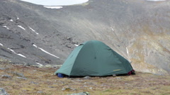Tourist tent is on a mountain top Stock Footage