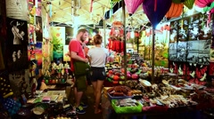 Vietnamese souvenirs at the night marketplace Stock Footage