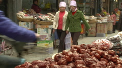 Hui women, vegetable market, Xian, China Stock Footage