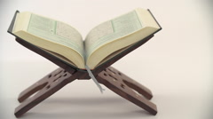 Holy Quran on stand. Stock Footage