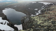 Huge lake at the canyon bottom, top view from the mountain plateau. Khibiny  Stock Footage