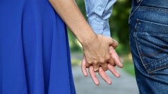 Young couple in love walking in the autumn park holding hands Stock Footage