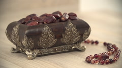 Dates container and prayer beads. Stock Footage