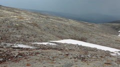 Plateau with snowfields and tundra terrain in the Khibins massif, Kola Stock Footage