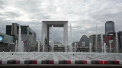 Cloudy view at fountain near La Grande Arche, Paris Stock Footage