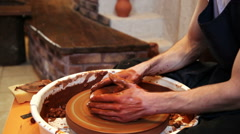 Potter working with clay in pottery Stock Footage