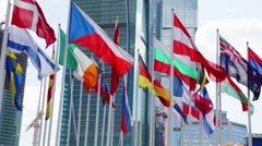 Flags of different countries waving in wind Stock Footage