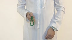 Emirati man holding prayer beads. Stock Footage