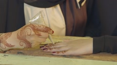 Arab woman applying henna on hands. Stock Footage