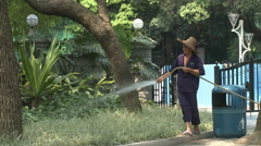 Chinese gardener watering plants, China Stock Footage