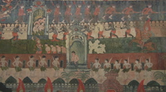 Paintings on the monastery wall in Luang Prabang, Laos Stock Footage