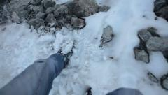 Pov view at hiker's legs riding down the snowy slope while mountaineering Stock Footage