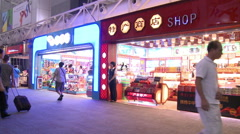 Brightly lit airport shops, Guangzhou, China Stock Footage