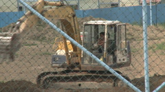 Construction excavator digging, China - stock footage
