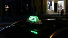 Taxi light on car roof in nighttime Paris. Stock Footage