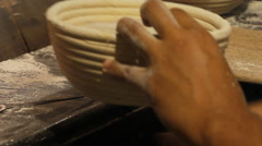 Baking bread pull out from the basket  Stock Footage
