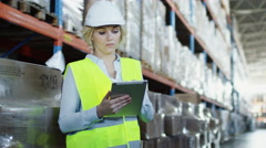 Female Worker of Logistic Warehouse is Working on Tablet PC Stock Footage