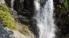 Flowing down streams of water, a waterfall in the mountains of Khibins, Russia Stock Footage