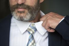 closeup of man loosens his shirt - stock photo