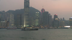 Hong Kong Harbor skyscrapers in evening Stock Footage