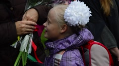 Stock Video Footage of the first-grader at school with flowers