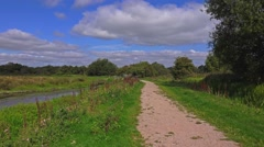 Footpath alongside river Stock Footage