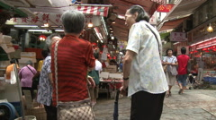 Old Chinese couple talking, Hong Kong alley Stock Footage