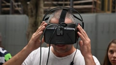 A man watches in the street a demonstration of virtual reality movie Stock Footage