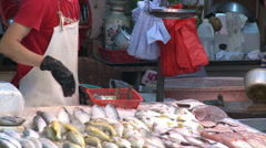 Hong Kong fishmonger, street market Stock Footage