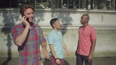 4k Young male friends hanging out in the city Stock Footage