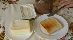 Butter and Chocolate Spread Ready For Hot Toast Bread Stock Footage