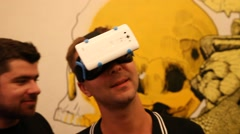 A man watches a demonstration of virtual reality movie Stock Footage
