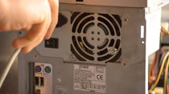Plug In And Turn On Power Unit PC - stock footage