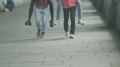 4k Happy energetic group of friends in London, playing piggyback races - stock footage